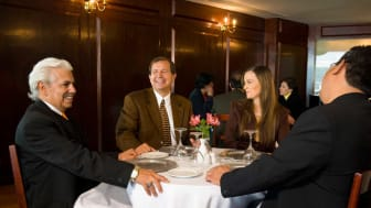 picture of four people at a business lunch