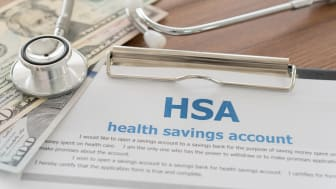 health savings account, HSA concept with application form,dollar money, stethoscope on desk.