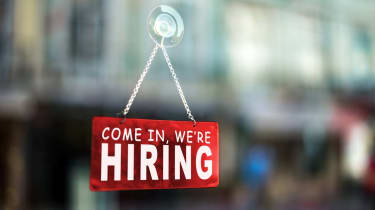 come in we're hiring sign on window