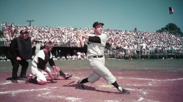 Yogi Berra, catcher for the New York Yankees, takes a swing in 1955.
