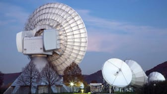 Satellite dishes at Erdfunkstelle Fuchsstadt Intelsat Teleport at dusk, near Hammelburg, Rhön, Bavaria, Germany