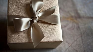 Gold Wrapping Paper and Bow made out of Beautiful Satin Ribbon makes any Gift even more Special