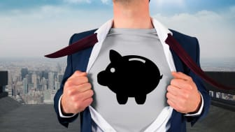 A man rips his shirt open to reveal a a piggy bank emblazoned on his chest.