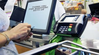 Cash register thank you messageat checkout counter in supermarket.