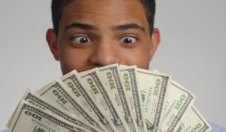 picture of man staring at one-hundred dollar bills