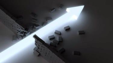 An arrow of light breaking through a brick wall