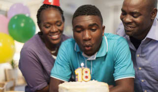 A son celebrating his 18th birthday with his parents