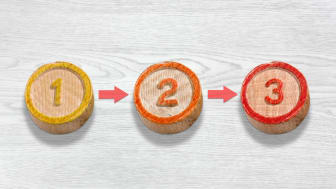 picture of three wooden tokens with the numbers 1, 2, and 3 on them