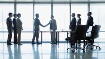 Businesspeople agreeing to a deal.