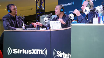 BLOOMINGTON, MN - FEBRUARY 01:(L-R) Former NFL player Tony Gonzalez and TV personalities Michael Yo and Tony Fly attend SiriusXM at Super Bowl LII Radio Row at the Mall of America on February