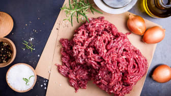 Organic homemade ground beef on craft paper ready to prepare burger or meatballs, top view