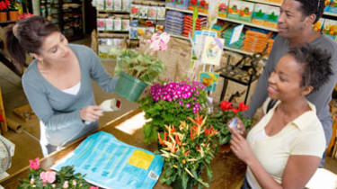 Couple Purchasing Potted Plants