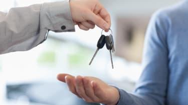 Man giving keys to someone