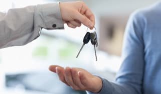 Man giving keys to someone