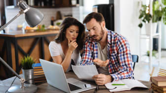 Couple reviewing credit card statement.