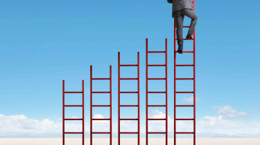 Red ladders staggered from shortest to tallest with man climbing tallest ladder
