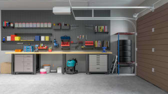 An organized residential garage with no vehicle inside