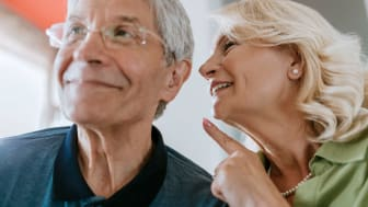 Senior couple with hearing aids