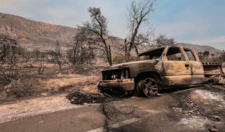 picture of a pickup truck burned by a wildfire