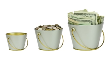 Three buckets with money, different sizes