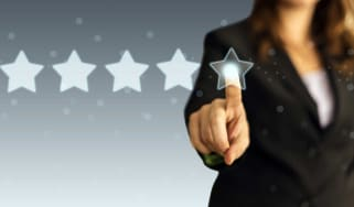 Woman selecting a five-star rating