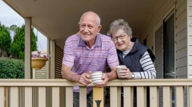 Senior couple having coffee on their front porch