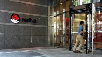 Raleigh, NC/USA - 5-11-2018: An employee enters the Red Hat headquarters building in downtown Raleigh, NC