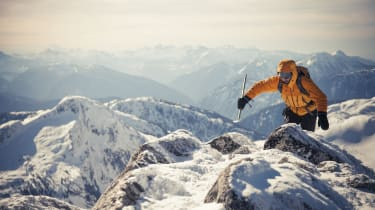 A mountaineer approaches the summit of a mountain in the Coquihalla Recreation Area of British Columbia, Canada.