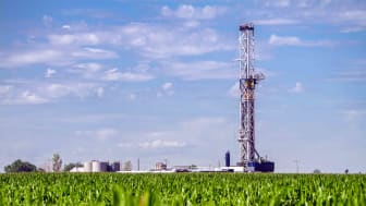 A fracking well in a cornfield