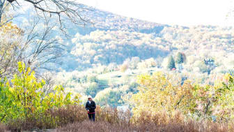 Senior hiking in the West Virginia mountains in the fall