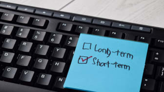 A Post-It note highlights a short-term, rather than long-term, investment