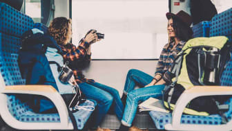 Passengers enjoy riding a train