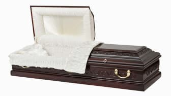 A partially open empty coffin