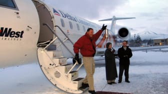 24 Jan 2002: Skywest Airlines CEO Jerry Atkin carries the Olympic Flame onto Alaskan soil for the first time in Olympic history during the 2002 Salt Lake Olympic Torch Relay in Juneau, Alaska