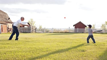 Learning how to his the baseball with Grandpa.Rural Alberta in the Spring