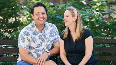 Comedians Noah Savage and Alyssa Wolff, laughing together
