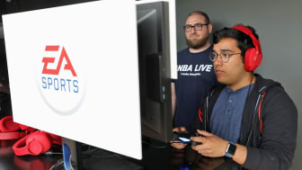 LOS ANGELES, CA - JUNE 10:Rahul Kishore (R) of New York, NY plays EA Sports 'NBA Live 18' during the Electronic Arts EA Play event at the Hollywood Palladium on June 10, 2017 in Los Angeles,