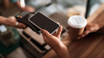 customer paying for coffee in cashless transaction